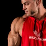 Red sleeveless hoodie by Body Spartan